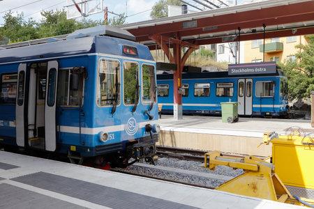 Stockholm, Sweden - July 28, 2016: Blue commuter trains at the terminal station Stoclkholm East station (Stockholms Ostra) end terminal for the suburban narrow gauge Roslagsbanan railway system.