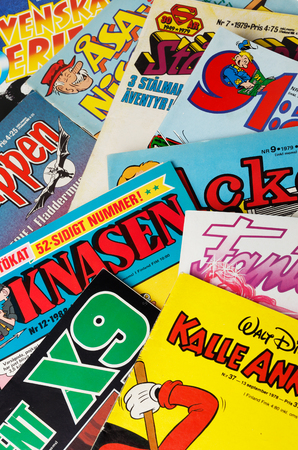batman: Stockholm, Sweden - August 21, 2016: Collage of Swedish comic books from the 1970s and 1980s, including Archie, Asa Nisse, Batman, the Phantom, 91 Karlsson, Donald Duck, Beetle Bailey, Superman and Agent X9.