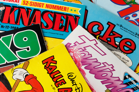 Stockholm, Sweden - August 21, 2016: Collage of Swedish comic books front pages from the 1970s and 1980s, including Archie, the Phantom, 91 Karlsson, Donald Duck, Beetle Bailey and Agent X9. Editorial