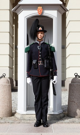 One female royal guard soldier in front of a sentry box at the royal palace in Oslo, Norway. Editorial