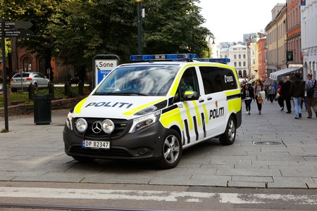down town: One Norwegian police vehicle patrolling i down town Oslo Editorial