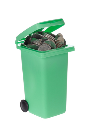 wasted: Green recycling bin with coins isolated on white background.