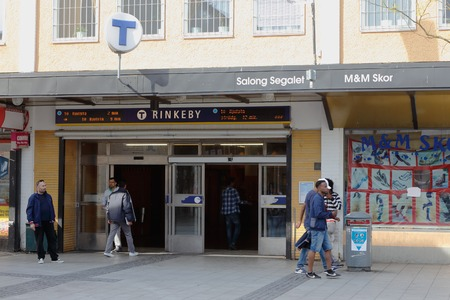 Stockholm, Sweden - May 23, 2016: People at the entrance to the Rinkeby metro station in the suburb district of Rinkeby.