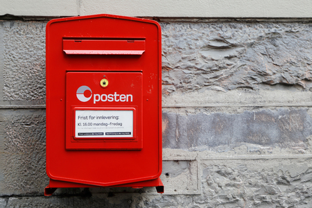 One red wall mounted post box operated by the Norwegian postal service Posten. Editorial