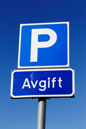 fee: Close up of Swedish road sign for car parking allowed if fee is paid. Stock Photo