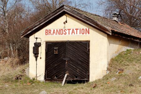 fire station: Exterior of an old small Swedish fire station located at the countryside.