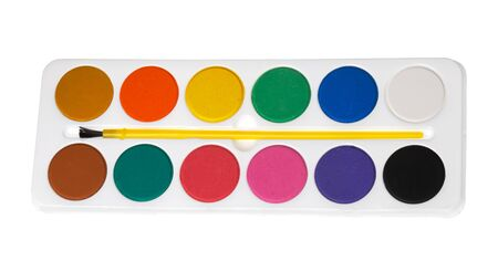 pallette: Brush attached to a pallette with watercolors on white background.