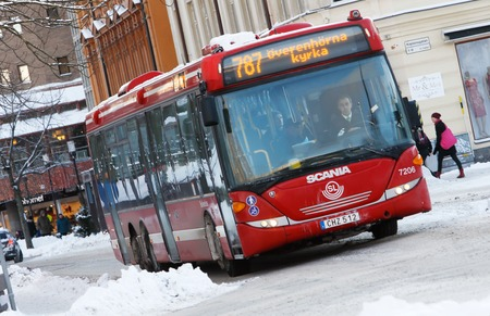 Sodertalje, Sweden - January 5, 2017:  Red public transport bus in service for the Greater Stockholm public transport, SL, at the street Storgatan, operates line 787.