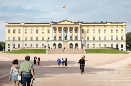Oslo, Norway - September 16, 2016: Frontal view of the royal palace in Oslo, Norway, with people strolling. Editorial