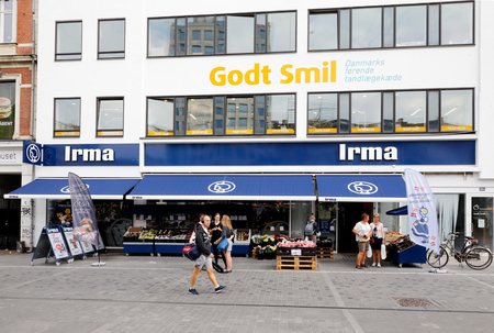 second floor: Copenhagen, Denmark - August 24, 2017: Exterior of the grocery store chain brand Irma at Norreport in downtown Copenhagen. In the buildings second floor a densist is located branded Godt smil. Editorial