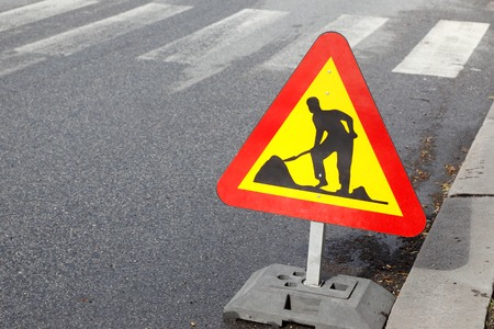 Roadwork traffic sign located on a street. Stock Photo