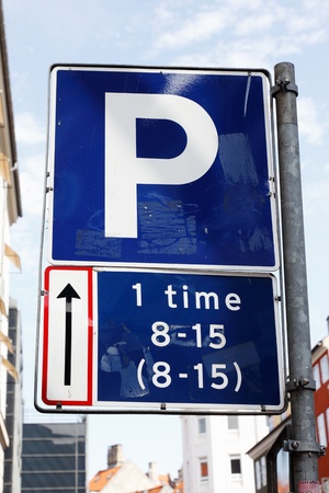Dansih parking road sign permits one hour of parking.