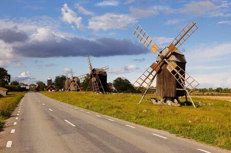Windmills of the class post mills at Lerkaka along side the road located in the Swedish province of Oland.