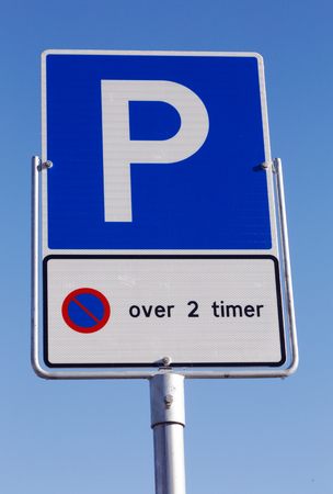Norwegian car parking sign allowed parking time 2 hours on blue sky. Stock Photo