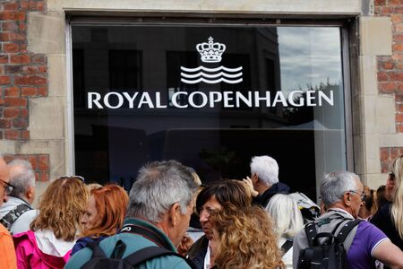 Copenhagen, Denmark - August 24, 2017: People outsiode the window at the Royal Copenhagen shop i the shopping district of Stroget. Editorial