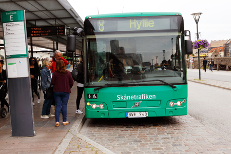 Malmo, Sweden - August 24, 2017: A green city bus in service for the public transportation company Skanetrafiken has stopped at the bus stop Centralen near the Malmo central railroad station.