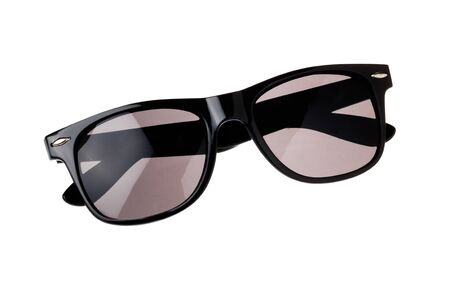 A pair of folded black sunglasses isolated on white background.