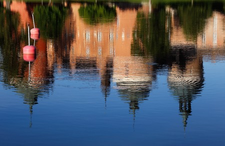 Reflection in the water of the Gripsholm Castle located in Mariefred, Sweden. Stock Photo