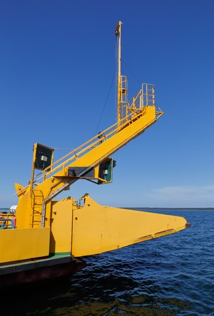 Close up a yellow Swedish small car ferry that replaces road where bridges are not available. Banco de Imagens
