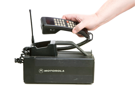 Hallstahammar, Sweden - December 10, 2012: One hand holdning the receiver of a 1980s era Motorola MCR 9500XL mobilephone used in Sweden.