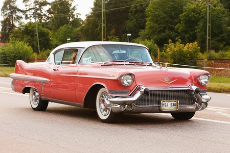 Vasteras, Sweden - July 5, 2013: One red Cadillac Coupe 1957 during cruising parade at the Power Big Meet event.