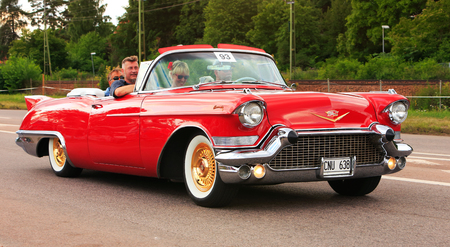 Vasteras, Sweden - July 5, 2013:   One red Cadillac Biarritz 1957 at the cruisning event during the Power big meet.