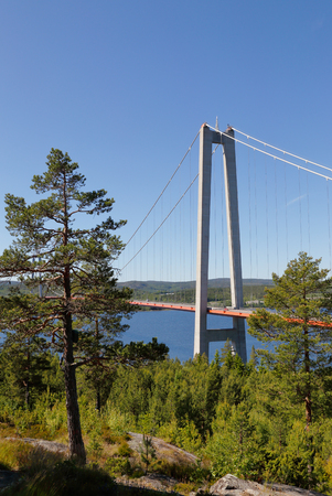 The suspension bridge at Hogakusten i Sweden carries road E4. Stock Photo