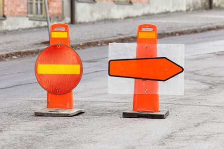Road signs for no entry and diversion direction arrow.