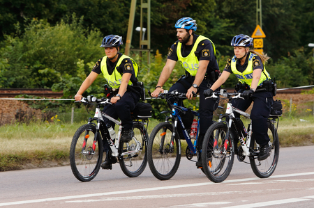 Vasteras, Sweden - July 5, 2013: Swedish police using bicycles