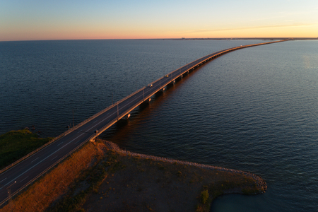 Aerial view during sunset of the Oland bridge crossing the Kalmar straight viewed from the island Oland to mainland Sweden. Stock Photo