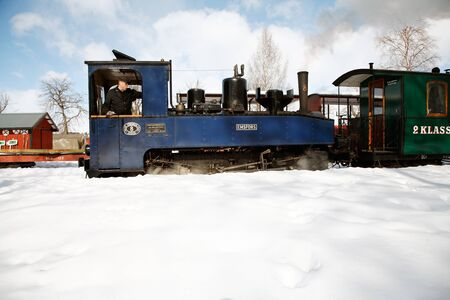 Mariefred, Sweden - March 19, 2006: Steam locomotive no 8 Emsfors coupled to passenger train at the Ostra Sodermanland railway museum. Redakční