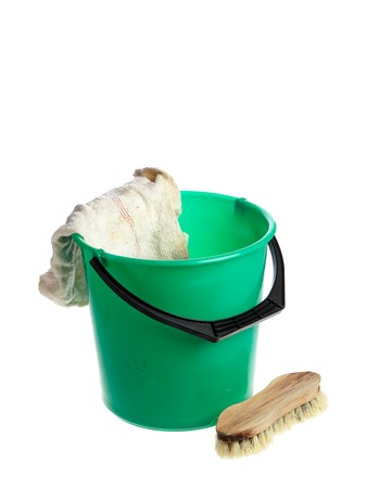 Green plastic bucket with a floorcloth hanging on its rim with a scrub brush near by isolated on white background. Banque d'images