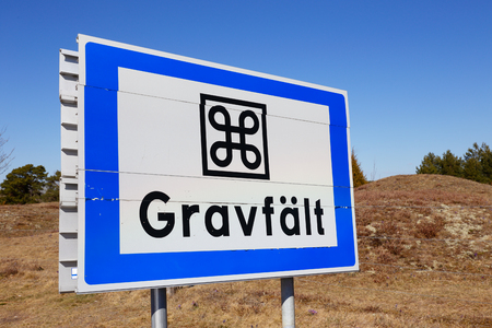 Road sign at an ancient burial site located in Sweden at Asa 스톡 콘텐츠