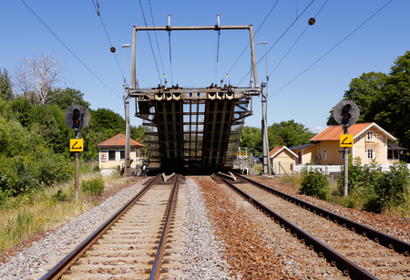 Openning of a double track railroad drawbridge with overhead contact line. Stock Photo