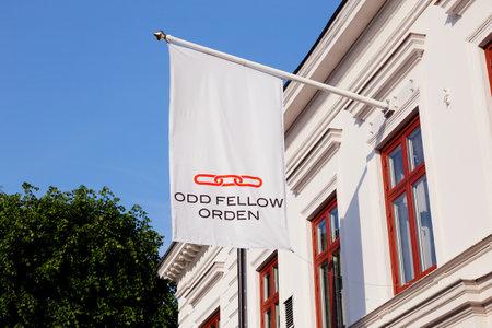Strangnas, Sweden - June 5, 2019: The Swedish Odd Fellows order flag outside its building located at 4 Kyrkogatan street.