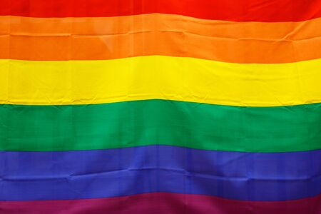 Close-up of a colorful rainbow flag.