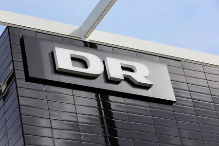 Copenhagen, Denmark - September 4, 2019: The Danish broadcatser DR Danmarks Radio logo on one of the buildings at the headquarters DR Byen loacated in the Orestad district.