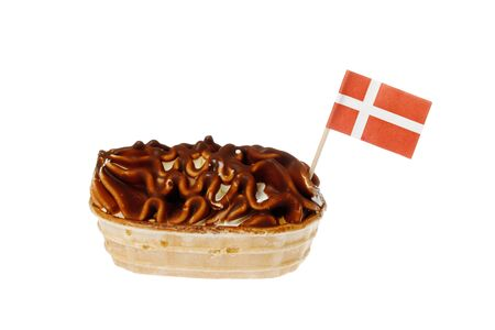 One chocolate covered ice cream boat with a Dansih flag flying isolated on white background.