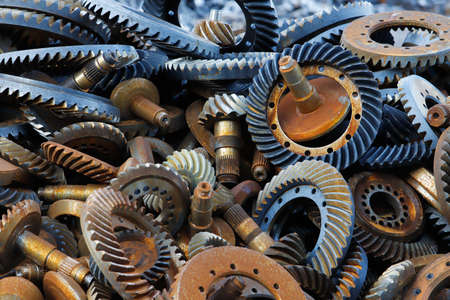 Full frame image of a pile of scrapped gearbox parts from the automotive industry.