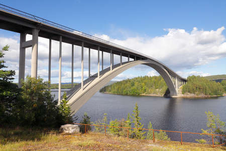 The Sando bride is an 264 m long arch bridge crossing the Swedish Angerman river and was opened in 1943.
