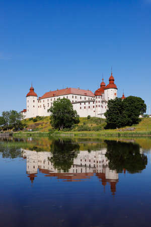 The medieval Lacko castle located in the Swedish province of Vastergotlande is reflected in lake Vanern. Sajtókép