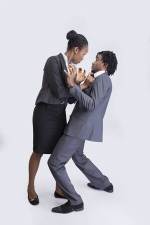 Business couple fighting photo