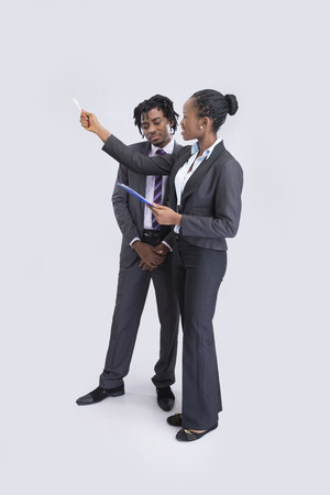 explanations: Businesswoman doing explanations to a young businessman