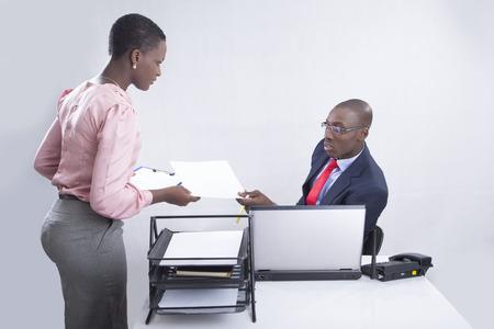 attending: Secretary attending to the boss  Stock Photo