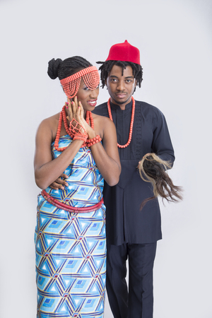 A couple in traditional attire posing