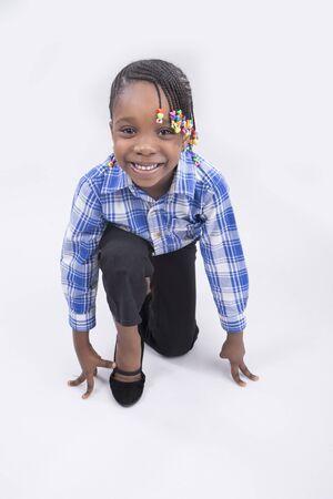 starting block: A little girl on  starting block