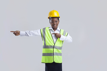 traffic warden: A young girl pointing towards a direction