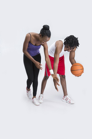 26 30 years: A couple at a game of basketball Stock Photo