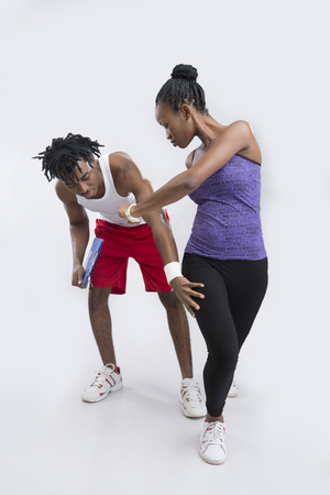 white singlet: A woman doing exercise with her personal fitness instructor