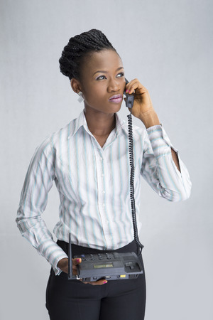 frowning: portrait of a businesswoman making a telephone call and frowning